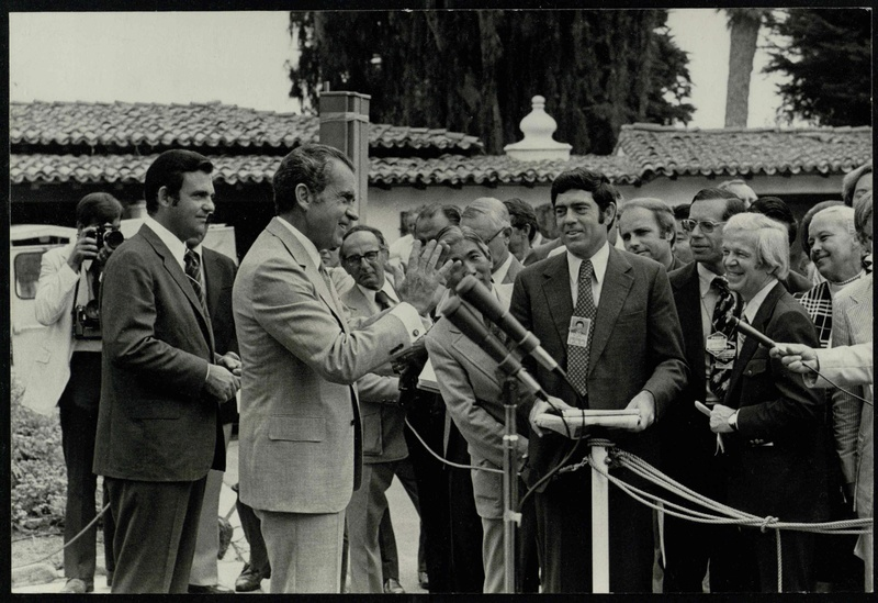 Picture – Nixon talks to the press during his 1972 China trip.