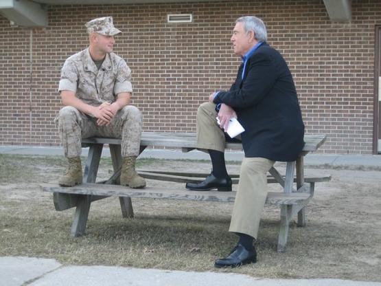 Dan Rather with U.S. Marine Corporal Yerandys Martell-Carrasco