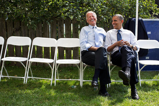 The president and vice president share a laugh before a campaign rally together in Portsmouth, N.H.